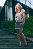 Happy smiling woman standing on stairs Royalty Free Stock Image
