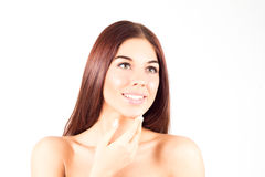 Happy smiling woman with straight red hair touching chin. Skin care concept. Beauty woman. Royalty Free Stock Photos