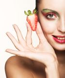 Happy smiling woman with strawberry Royalty Free Stock Photography