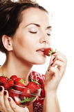 Happy smiling woman with strawberry Royalty Free Stock Photos