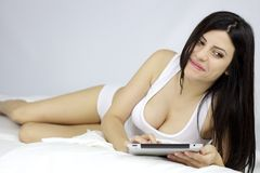Happy smiling woman with tablet in bed Royalty Free Stock Images