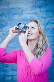 Happy smiling woman taking photo on retro vintage Royalty Free Stock Images