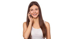 Happy smiling woman talking on mobile phone, isolated on white background. Beautiful girl with a smartphone Stock Images