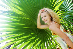 Happy smiling woman on tropical natural background Royalty Free Stock Images