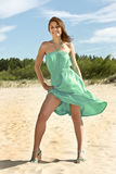 Happy smiling Woman in turquoise. On the beach Stock Photos