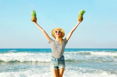 Happy smiling woman with two a pineapples on a sunny summer Stock Photo