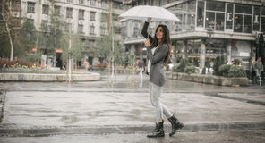 Happy smiling woman under umbrella in rain. Portrait of happy smiling woman under umbrella in rain Stock Photo