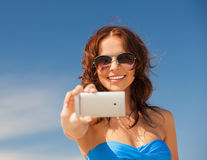 Happy smiling woman using phone camera Royalty Free Stock Images