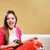Happy smiling woman using smartphone. Technology. Stock Image