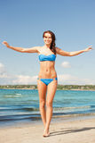Happy smiling woman walking on the beach. Picture of happy smiling woman walking on the beach Stock Photos