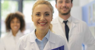 Happy Smiling Woman Walking With Team Of Doctors In Modern Laboratory Successful Researchers Group Royalty Free Stock Image