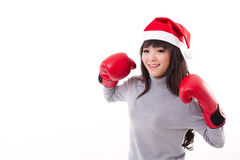 Happy, smiling woman wearing X'mas santa hat, boxing gloves Royalty Free Stock Images