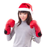 Happy, smiling woman wearing X'mas santa hat, boxing gloves Stock Photo