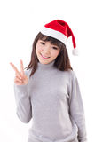 Happy, smiling woman wearing X'mas santa hat, showing v sign Stock Image