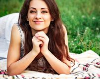 Free Happy Smiling Woman With Green Amazing Eyes Looking In Camera Lying On The Green Summer Grass. Closeup Stock Photography - 160592152