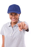 Happy, smiling woman worker or service staff pointing at you Royalty Free Stock Photos