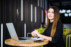 Happy smiling woman working with laptop in modern smart space hub Stock Photography