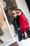 Happy smiling women shopping with white bags Royalty Free Stock Images