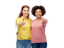 Happy smiling women showing thumbs up Royalty Free Stock Images
