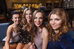 Happy smiling women taking selfie at night club Royalty Free Stock Photography