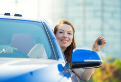 Happy, smiling, young attractive woman, buyer sitting in her new. Closeup portrait happy, smiling, young attractive woman, buyer sitting in her new blue car royalty free stock images