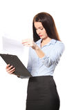 Happy smiling young beautiful business woman with clipboard writ Stock Photos