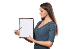 Happy smiling young beautiful business woman with clipboard writ Stock Images