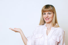 Happy smiling young beautiful business woman showing blank area. For sign or copyspase,  over white background Stock Photos