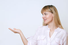 Happy smiling young beautiful business woman showing blank area. For sign or copyspase Stock Photo