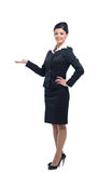Happy smiling young beautiful business woman showing blank area Stock Photography