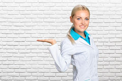 Happy smiling young beautiful female doctor Stock Images