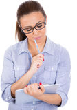 Happy, smiling, young, beautiful woman/student or businessperson with eye glasses puzzled and confused Stock Photography