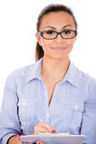 Happy, smiling, young, beautiful woman/student or businessperson with eye glasses writing notes Stock Photos