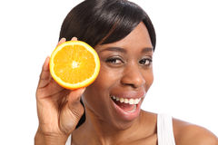 Happy smiling young black woman with orange fruit Stock Photos