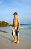 Happy smiling young boy at the beach Royalty Free Stock Images