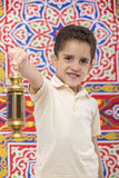 Happy Smiling Young Boy Celebrating Ramadan with Lantern. Over Festive Ramadan Curtain Stock Photo