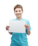 Happy smiling young boy with a sheet of paper Stock Photos