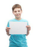 Happy smiling young boy with a sheet of paper Royalty Free Stock Images
