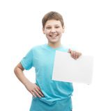 Happy smiling young boy with a sheet of paper Royalty Free Stock Photo