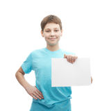 Happy smiling young boy with a sheet of paper Royalty Free Stock Photography