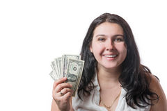 Happy smiling young brunette woman holding american dollar money isolated on white. Positive emotions and happiness concept.  Stock Photos