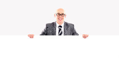 Happy smiling young business man showing blank signboard Stock Photos