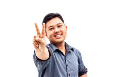 Happy smiling young business man showing two fingers. Or victory gesture, isolated over white background Royalty Free Stock Photos