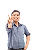 Happy smiling young business man showing two fingers. Or victory gesture, isolated over white background Stock Image