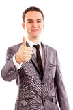 Happy smiling young business man with thumb up gesture Royalty Free Stock Image