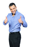 Happy smiling young business man with thumbs up gesture. Isolated over white background stock photo