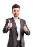 Happy smiling young business man with thumbs up gesture. Isolated over white background royalty free stock image