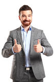 Happy smiling young business man with thumbs up gesture. Isolated over white background stock photography