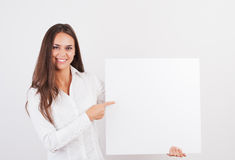 Happy smiling young business woman. Showing blank signboard, isolated on white background Stock Photos