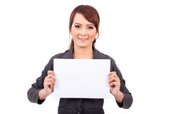 Happy smiling young business woman holding blank signboard, Royalty Free Stock Image